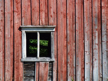 Old window. Empty window without glass in an old Norwegian farm building Stock Image