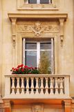 Old window. With balcony and flower boxes in Paris France Royalty Free Stock Photography