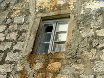 Old window. On stone building stock photos