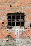 Old window. Window with iron bars on old facade with bricks Stock Photos