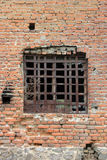 Old window. Window with iron bars on old facade with bricks Royalty Free Stock Photo