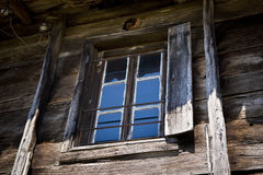 Old Window. Reflecting blue sky Stock Image