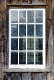 Old Window. Old weathered window - white frame on a wooden house stock photos