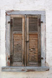 Old window. Old ragget window on a  white walli Stock Images