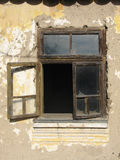 Old window. Old brown window left open on old house with ruined walls Royalty Free Stock Photos
