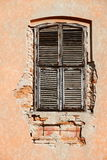 Old window. Old vintage unattained house window on ruined facade Stock Images