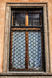An old window in an ancient beautiful building Royalty Free Stock Image