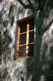 Old  window and ancient stonework Stock Photos
