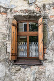 Old window on ancient wall Royalty Free Stock Photo