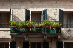 A old window and balcony. A old window and balcony on a historical building royalty free stock image