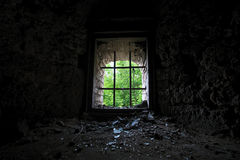 An old window with bars facing the nature Stock Photography