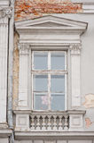 Old window with beautiful architecture modeling and columns Stock Image