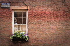 The Old Window. A beautiful ornamental window in a brick wall Royalty Free Stock Photography