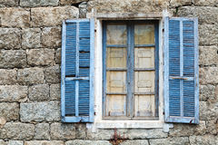 Old window with blue open shutters Stock Photography
