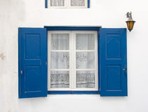 Old window with the blue shutters. Background. Royalty Free Stock Photos