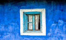 Old Window on a Blue Wall Royalty Free Stock Photo