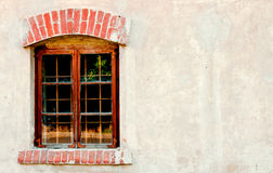 Old window on a brick wall Stock Photos