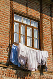 Old window in brickwork with laundry Stock Images