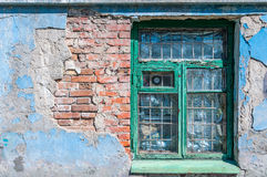 Old window with a broken brick wall Stock Photo