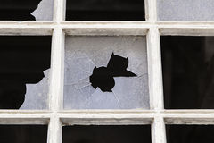 Old window with broken glass Stock Photography