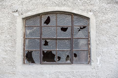 Old window with broken glass Stock Photo