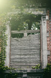 Old window with broken wooden shutters Royalty Free Stock Images