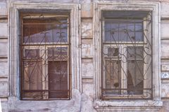 Old window of an building with broken glass stock photo