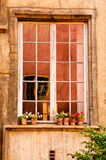 Old window with building reflections Royalty Free Stock Photos
