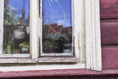 Old window in burgundy paunted wood wall royalty free stock photography