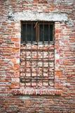 Old window closed with bricks. Stock Photos