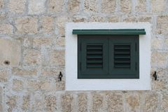 Old window closed green shutters Royalty Free Stock Image