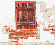 Old window with closed shutters Stock Photo