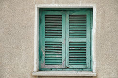Old window with closed shutters Royalty Free Stock Photo