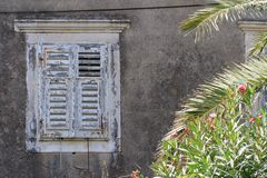Old window closed with shutters. Europe Royalty Free Stock Photos