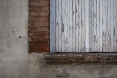 Old window with closed shutters Royalty Free Stock Images