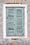 Old window with closed shutters on an old house Royalty Free Stock Photo