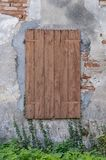 Old window with closed shutters Royalty Free Stock Image
