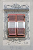 Old window with closed shutters stock photography