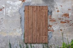 Old window with closed shutters Stock Image