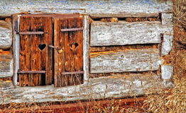 Old window with closed woody shutter. And old rust padlock Stock Photography