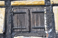 Window Shutter. An old closed window shutter of a XVIIIth century old Danish house Royalty Free Stock Images