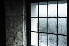 Old window on a cold and rainy day. Photo of a wet window taken from inside an old building Royalty Free Stock Photography