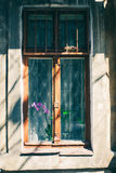 Old window with cracked paint, vintage brick wall background with old window Royalty Free Stock Photography