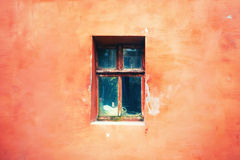 Old window with cracked paint, vintage brick wall background with old window Stock Photography