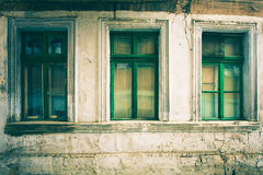 Old window with cracked paint, vintage brick wall background with old window Royalty Free Stock Photo