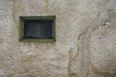 Old window cracks on the wall. Green old window with cracks on the wall Stock Photography