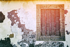Old window with cracky wooden shutters Stock Images