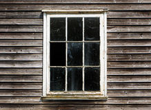 Old window with a curtain of the wooden house Royalty Free Stock Photography