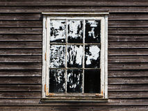 Old window with curtain of a wooden house Stock Photos