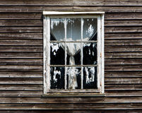 Old window with a curtain of wooden house Royalty Free Stock Images